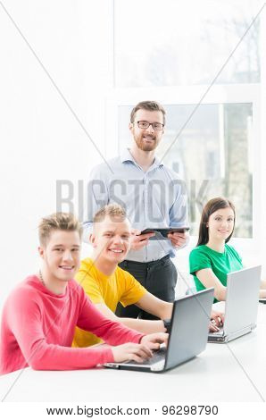 Students at the informatics and programming lesson  poster