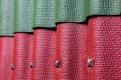 Close up colorful samples of corrugated roofing poster