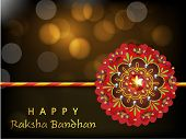 Beautiful creative rakhi on shiny background for Indian festival of brother and sister love, Happy Raksha Bandhan celebration. poster
