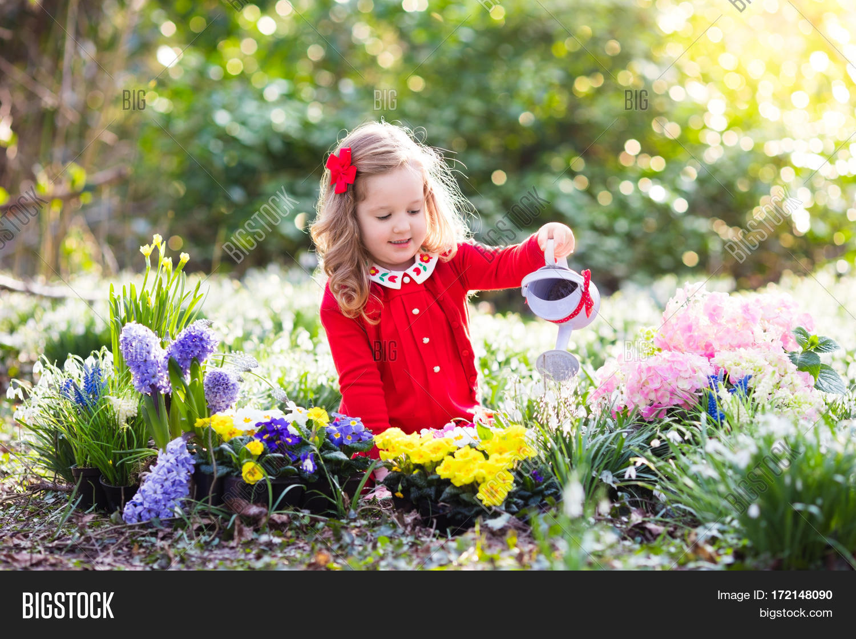 Child planting spring image photo free trial bigstock child planting spring flowers in sunny garden little girl gardener plants hyacinth daffodil snowdrop in mightylinksfo