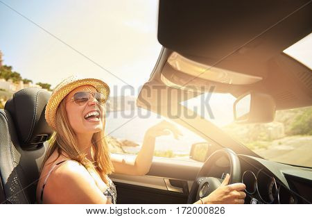 Woman Laughing While Driving Fancy Car