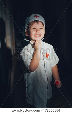 The child in the doctor's suit on a black background