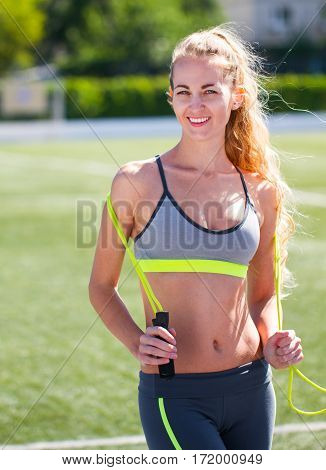 Beautiful Sports Blonde The Woman With A Jump Rope At Stadium. Summer Sport In The Open Air.