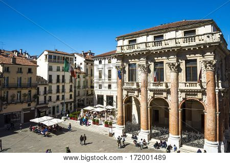 VICENZA,ITALY-APRIL 3,2015:people stroll in front of the Capitaniato lodge in the Vicenza town square .during a sunny day.