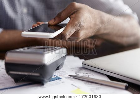 People And Modern Technology Concept. Close Up Of African Businessman's Hand Holding Copy Space Smar