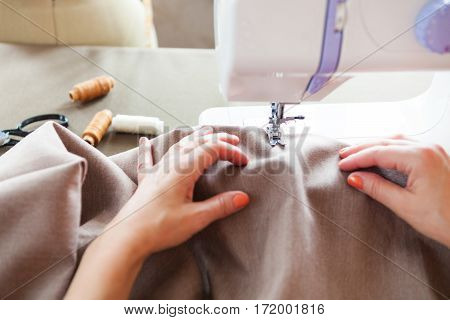 Woman Tailor Working On Sewing Machine. Hands. Close Up.  Tailoring.