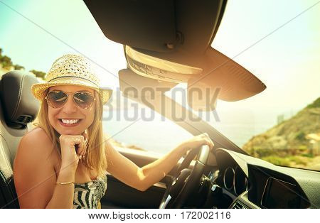 Cute Woman Driving Convertible Car