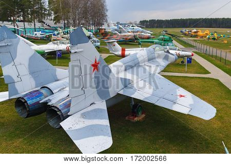 Minsk Belarus - April 25 2015: Obsolete Soviet jet. Old military aircraft. Many airplanes helicopters and various aircraft. Selective focus