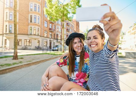 Two Happy Young Women Taking Their Selfie