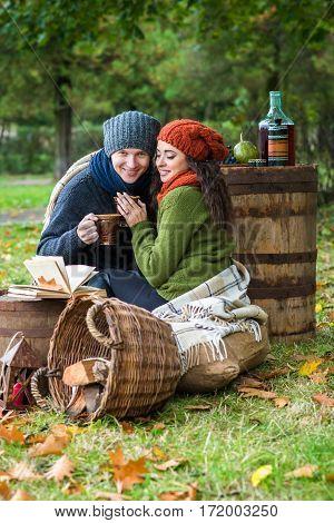 loving couple sitting in the autumn garden
