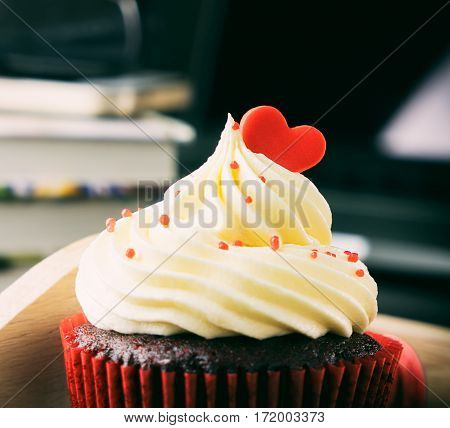 Valentines Cupcake romance on office table vintage tone