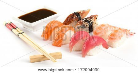 sashimi with chopsticks and soy on white background
