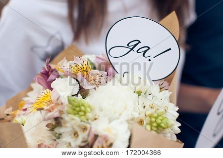 Sign Yes in a wedding bouquet close-up
