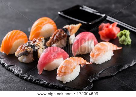 sashimi served on stone slate