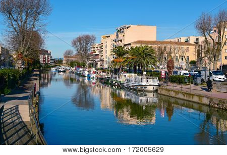NARBONNE, FRANCE - DECEMBER 27, 2016: The Canal de la Robine channel as it passes through Narbonne, France. This channel is a lateral branch of the Canal du Midi which connects with the River Aude