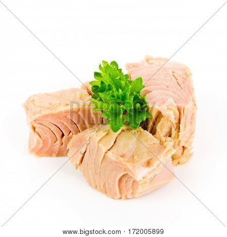 pieces of tuna with parsley isolated on white