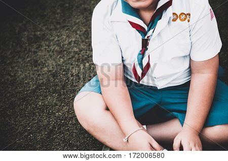 Group Of Asian Boy Scout Sitting On Greensward For Relax Time. Asia Boy Scout General Uniform Concep