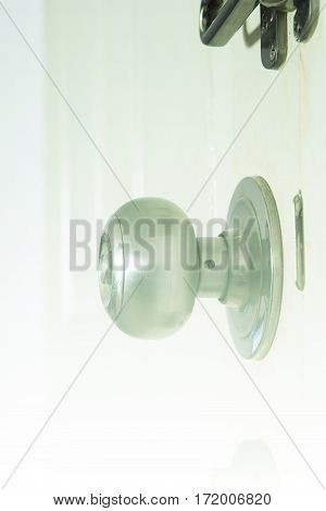 Close up of aluminum door knob background