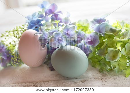 Easter decoration in tender colors on a white shabby wooden table
