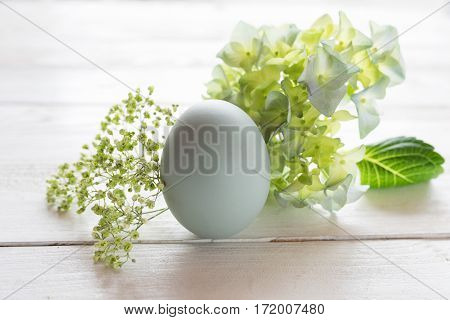 Tender easter decoration on a white wooden table