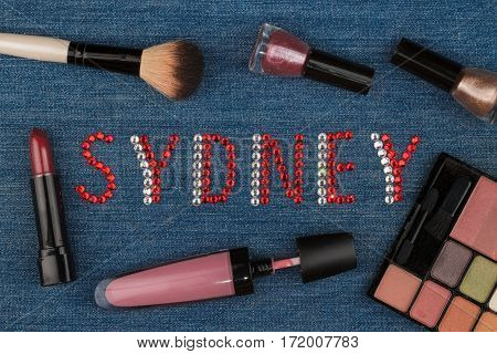 Sydney. World capitals of fashion. Word inlaid rhinestones and cosmetics. View from above