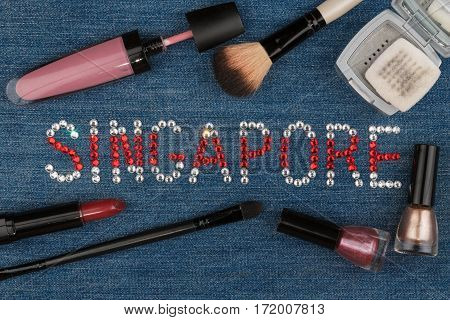 Singapore. World capitals of fashion. Word inlaid rhinestones and cosmetics. View from above