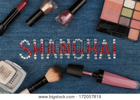 Shanghai. World capitals of fashion. Word inlaid rhinestones and cosmetics. View from above