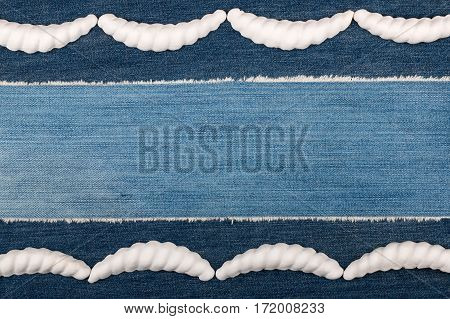 Luxury elegant frame made of white stucco plaster lying on denim. Copy space. View from above