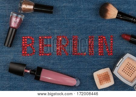 Berlin. World capitals of fashion. Word inlaid rhinestones and cosmetics. View from above