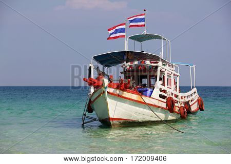 Drifting boat in the transparent sea. Thailand