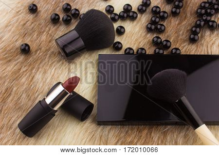 Makeup Tools On Fur Background / Featuring Eyeshadow Palette, Lipstick, Makeup Brushes On A Fury Bac