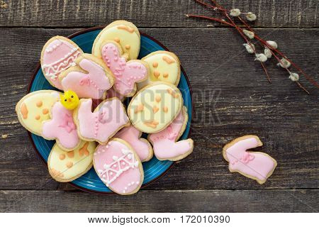 Easter Background. Easter Cookies On A Plate And Twigs Of Willow On A Wooden Table. Easter Recipe.