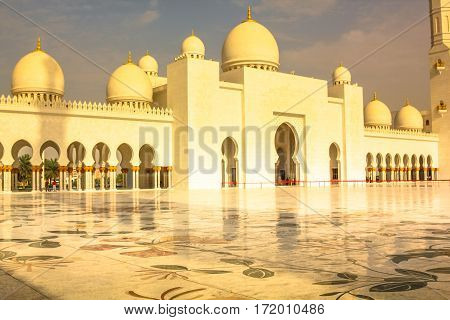 Abu Dhabi, United Arab Emirates - April 22, 2013: scenic view at sunset of Sheikh Zayed Grand Mosque, Abu Dhabi, the third largest mosque in world. Islamic cultures concept and muslim religious icon.
