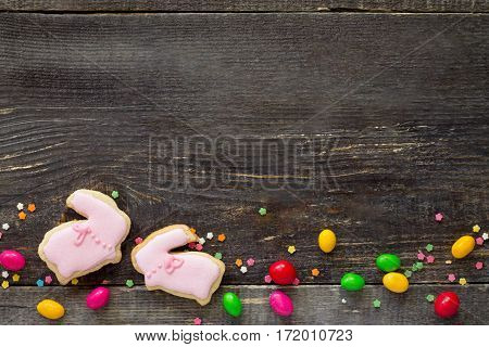 Easter Frame. Easter Bunny Cookies And Confectionery Sugar Sprinkling On A Wooden Table. Easter Reci