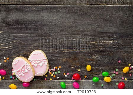Easter Frame. Cookies Easter Eggs And Sugar Confectionery Sprinkling On A Wooden Table. Easter Recip