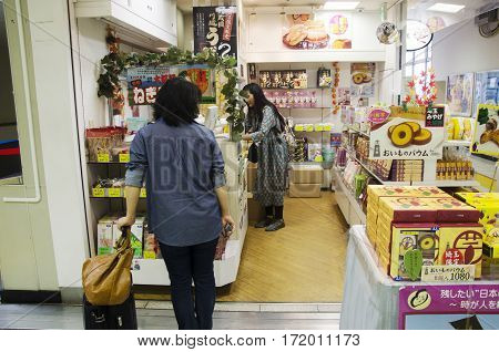 Japanese people sell snack and food to thai women in souvenirs shop at Kawagoe station in Saitama city of Kanto on October 19 2016 in Saitama Japan