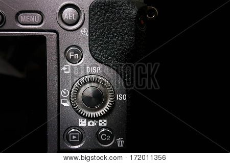 Control dial on a DSLR camera, mirrorless,  close up image isolated on black background