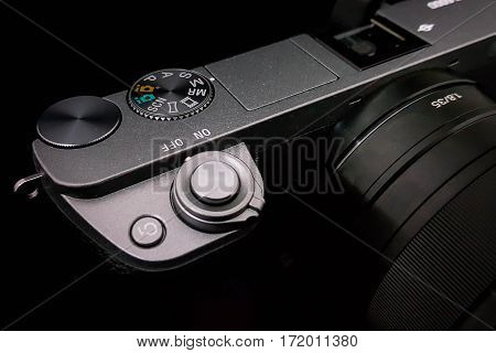 Shutter button on a DSLR camera, mirrorless, close up image isolated on black