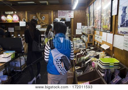 Japanese People And Foreigner Traveler Shopping Snack And Food In Souvenir Shop Old Style In Saitama