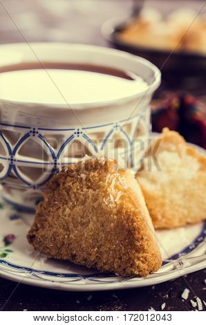 Triangular cookies with coconut and sugar. Selective focus.