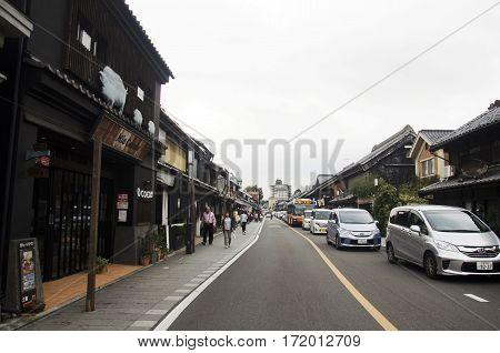Japanese And Foreigner Walking And Visit Street And Clay Walled Warehouse Style Building At Kawagoe