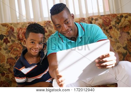 Boy Playing Game With Father On Laptop Pc