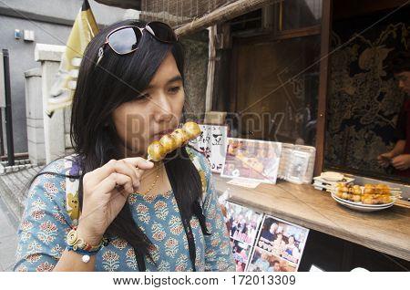 Traveler Thai Woman Eating Mitarashi Dango Japanese Snack Style At Kawagoe Town