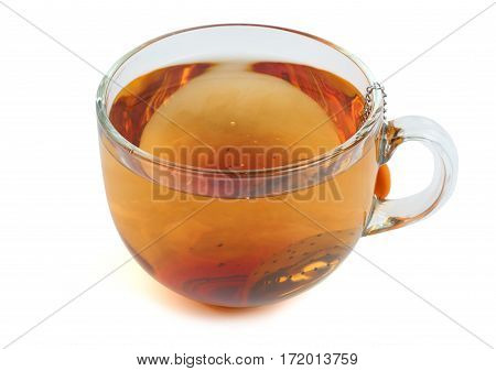 Brewing black tea in the transparent glass cup with tea strainer. Isolated on white