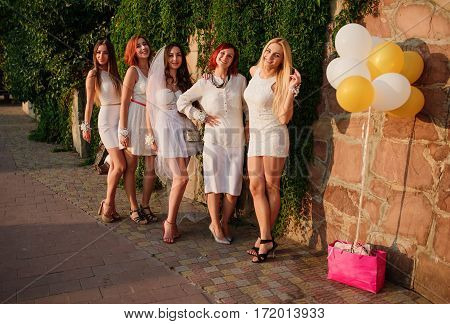 Group Of Girls Posed At Sunset Day At Hen Party.