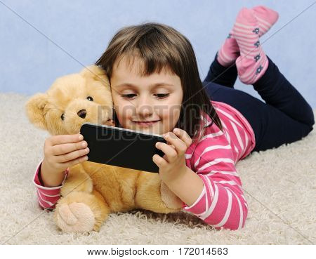 cute little girl with smart phone