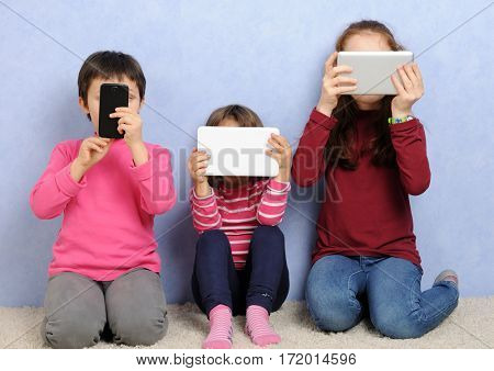 little girls with electronic devices