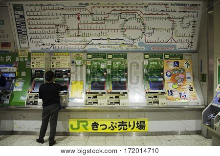 Japanese People Buying Tickets Of Train From Automatic Vending Machine At Komagawa Railway Station