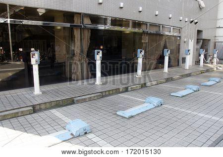 Vending Machine meter of car parking beside traffic road for people use at Shinjuku city on October 20 2016 in Tokyo Japan