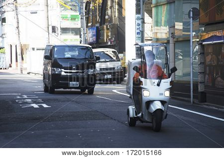 Japanese People Driving Car And Riding Motorcycle On The Road In Small Alley